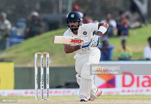 Indian cricket team captain Virat Kohli plays a shot during the first day of the opening Test match between Sri Lanka and India at the Galle...