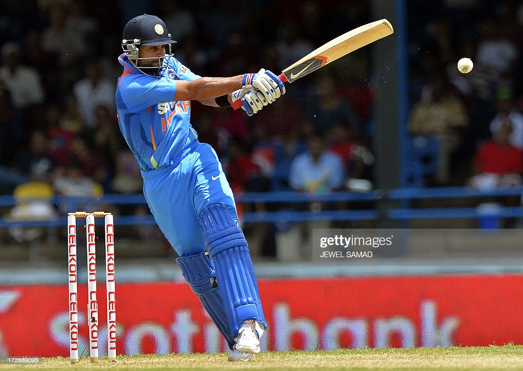 Indian cricket team captain Virat Kohli plays a shot during the fourth match of the Tri-Nation series between India and West Indies at the Queen's Park Oval in Port of Spain on July 5, 2013. West Indies won the toss and elected to field. AFP Photo/Jewel Samad