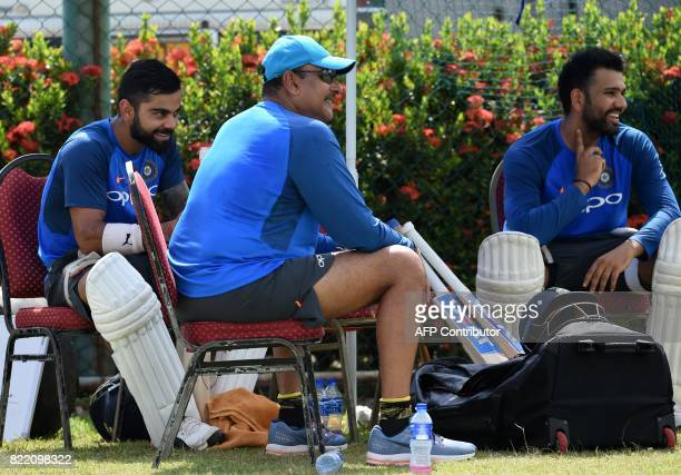 Indian cricket team captain Virat Kohli Rohit Sharma and newlyappointed coach Ravi Shastri take part in a practice session at Galle International...