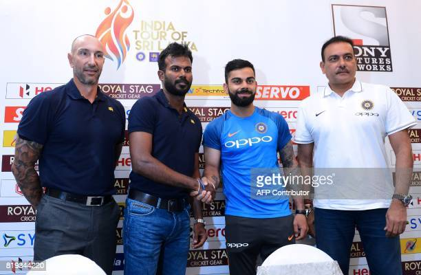 Indian cricket team captain Virat Kohli shakes hands with Sri Lankan oneday international and Twenty20 captain Upul Tharanga as Indian cricket team...