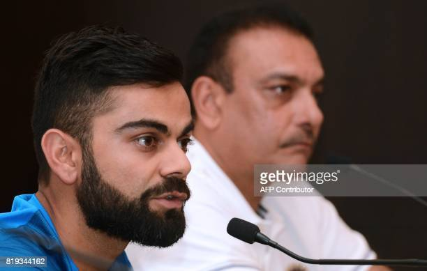 Indian cricket team captain Virat Kohli speaks as newlyappointed coach Ravi Shastri looks on during a press conference in Colombo on July 20 2017...