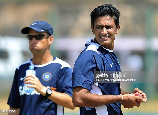 Indian cricket team coach Gary Kirsten captain Anil Kumble watch colleagues during a practice session at The Galle International Cricket Stadium in...