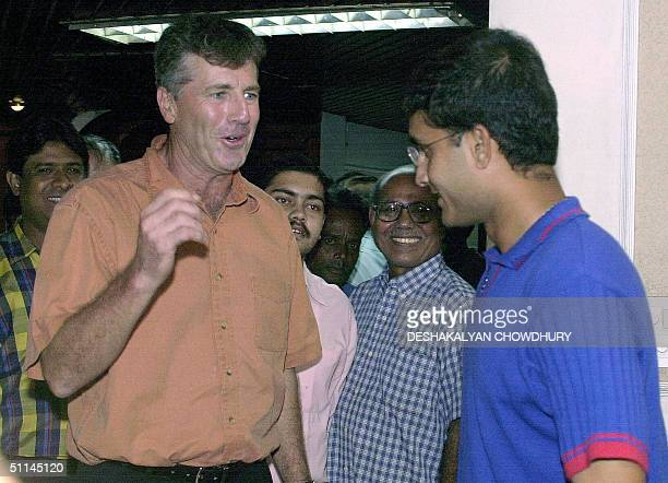 Indian cricket team coach John Wright chats with Indian captain Sourav Ganguly at the Eden Gardens in Calcutta 05 August 2004 India's 14man squad was...