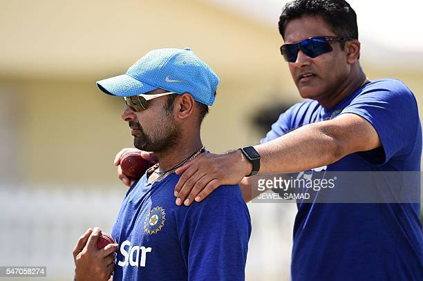 Indian cricket team head coach Anil Kumble chats with bowler Amit Mishra during a practice session at the Warner Park stadium in Basseterre Saint...