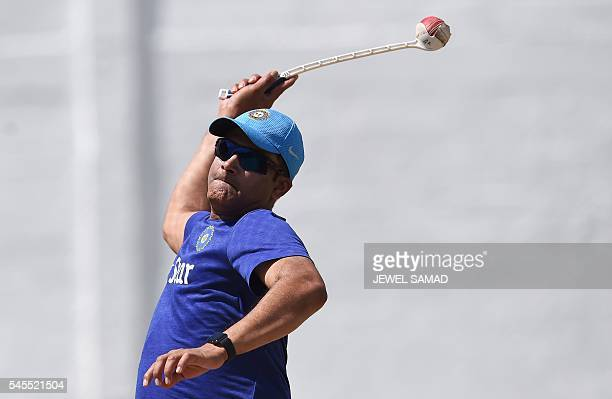 Indian cricket team head coach Anil Kumble delivers a ball during a practice session at the Warner Park stadium in Basseterre Saint Kitts on July 8...