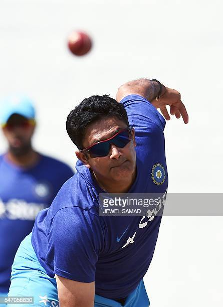 Indian cricket team head coach Anil Kumble delivers a ball during a practice session at the Warner Park stadium in Basseterre Saint Kitts on July 13...