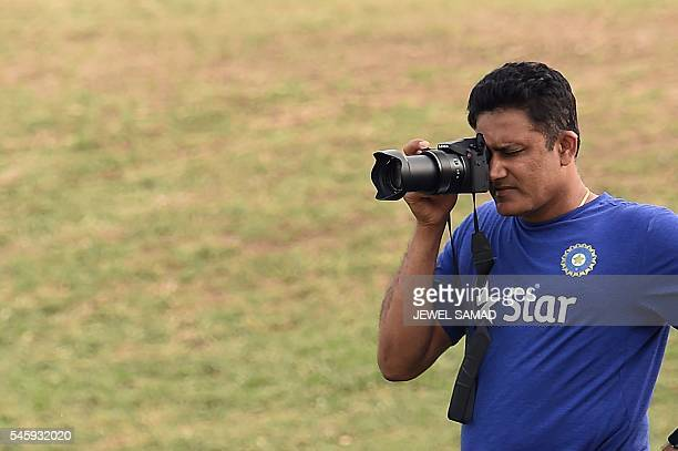 Indian cricket team head coach Anil Kumble takes pictures during the second day of a twoday tour match between India and WICB President's XI squad at...
