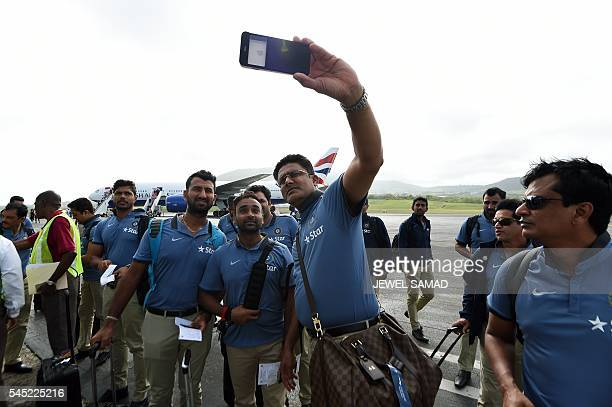 Indian cricket team head coach Anil Kumble takes selfie as his team arrives at the airport in Basseterre Saint Kitts on July 6 2016 Indian cricket...