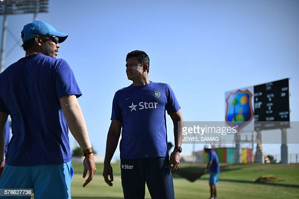 Indian cricket team head coach Anil Kumble talks with cricketer Umesh Yadav at the end of the threeday tour match between India and WICB President's...