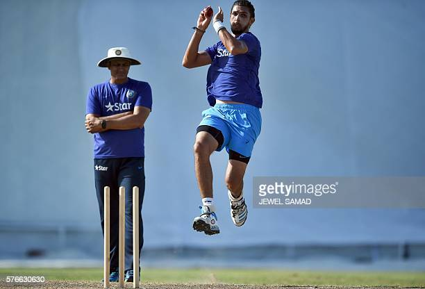 Indian cricket team head coach Anil Kumble watches bowler Ishant Sharma delivering a ball as he practices at the end of the threeday tour match...