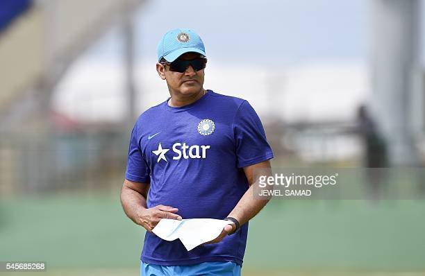 Indian cricket team head coach Anil Kumble watches his team before the start of a tour match between India and WICB President's XI squad at the...