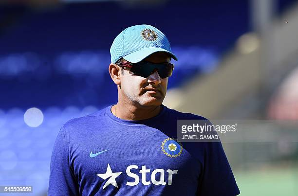 Indian cricket team head coach Anil Kumble watches his team during a practice session at the Warner Park stadium in Basseterre Saint Kitts on July 8...