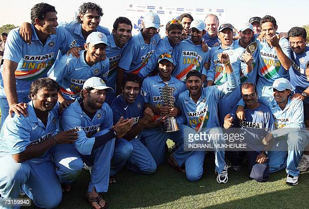 Indian cricket team members pose with the cup after winning the fourth One Day International match against the West Indies in Vadodara 31 January...