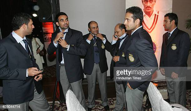 Indian cricket team members Yuvraj SIngh Zahir Khan Virendra Sehwag manager Lalchand Rajput Irfan Pathan and MS Dhoni gets ready for the group photo...