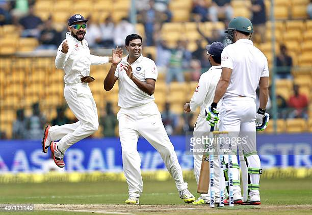 Indian cricket team player Ravichandran Ashwin and Captain Virat Kohli celebrate the dismissal of South African player Faf du Plessis during the 2nd...