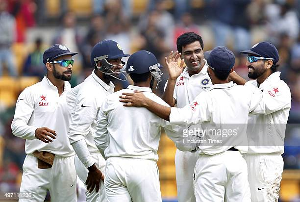 Indian cricket team player Ravichandran Ashwin and captain Virat Kohli celebrate the dismissal of South African player Stiaan van Zyl during the 2nd...