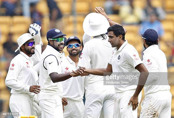 Indian cricket team player Ravichandran Ashwin celebrates with teammates after dismissal of South African player Faf du Plessis during the 2nd Test...