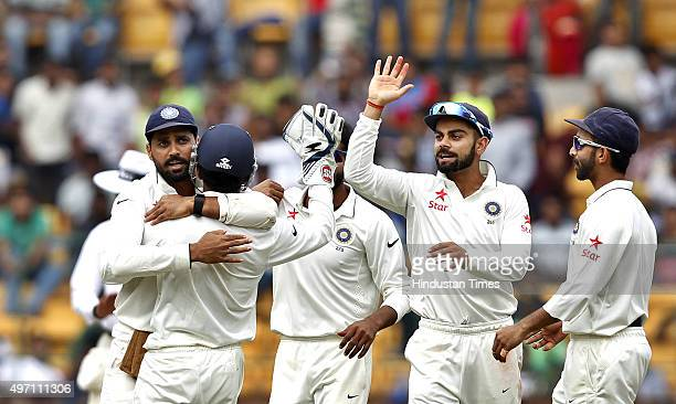 Indian cricket team player Ravindra Jadeja and captain Virat Kohli celebrate the dismissal of South African player AB de Villiers during the 2nd Test...