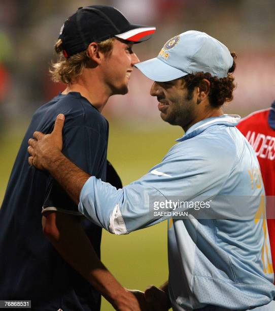 Indian cricket team player Yuvraj Singh smiles while being greeted by England's fast bowler Stuart Broad who he hit for 6 sixes in an over 19...