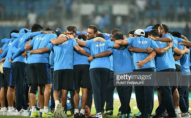 Indian cricket team players stand in a huddle before the start of the World T20 cricket tournament match between India and New Zealand at The...