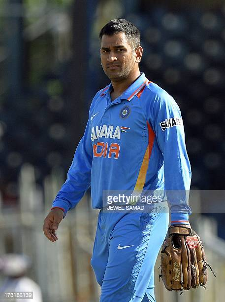 Indian cricket team regular captain Mahendra Sing Dhoni warms up before the start of the second innings during the sixth match of the TriNation...