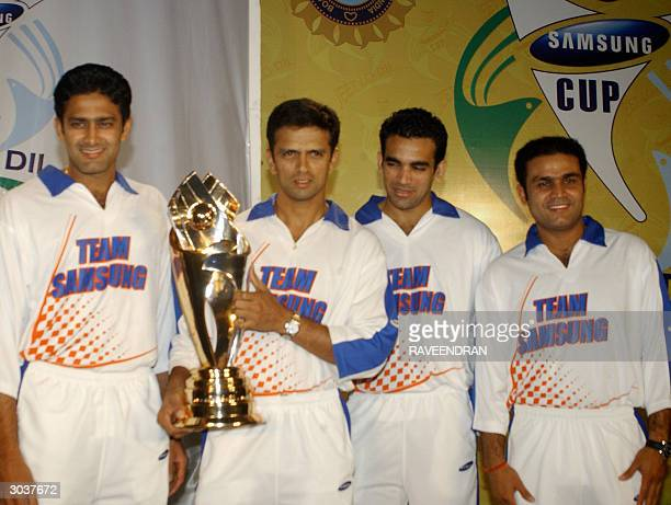 Indian cricket team vicecaptain Rahul Dravid holds The 'Samsung Cup' as teammates Anil Kumble Zaheer Khan and Virender Sehwag look on during the...