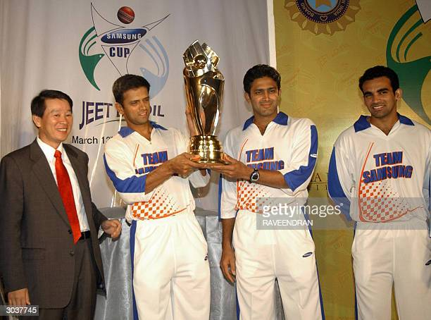 Indian cricket team vicecaptain Rahul Dravid holds The 'Samsung Cup' with teammate Anil Kumble as Zaheer Khan and Managing Director Samsung India...