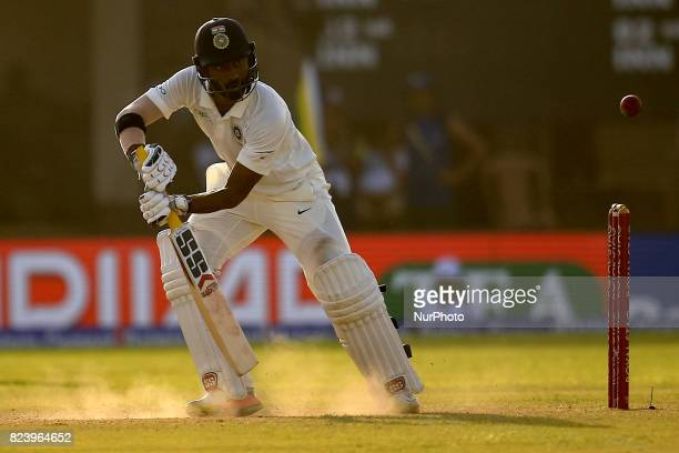 Indian cricketer Abhinav Mukund plays a shot during the 3rd Day's play in the 1st Test match between Sri Lanka and India at the Galle cricket stadium...