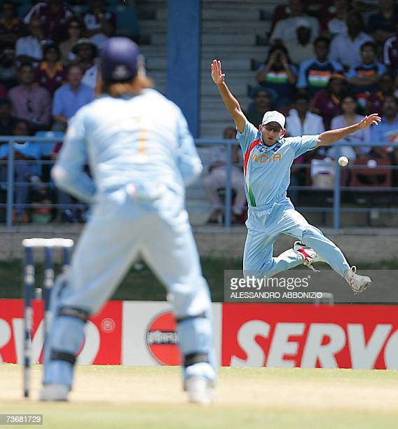 Indian cricketer Agit Agarkar jumps for a catch off the bat of Sri Lankan batsman Kumar Sangakkara at the Queen's Park Oval in Port of Spain in...