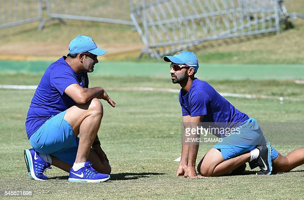 Indian cricketer Ajinkya Rahane listens to team head coach Anil Kumble during a practice session at the Warner Park stadium in Basseterre Saint Kitts...