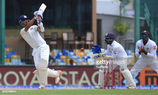 Indian cricketer Ajinkya Rahane misses the ball as Sri Lankan wicket keeper Niroshan Dickwella awaits to remove the bails during the 2nd Day's play...