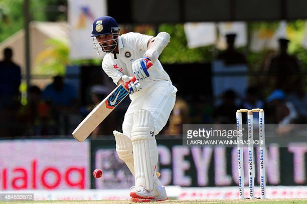 Indian cricketer Ajinkya Rahane plays a shot during the opening day of their second Test match between Sri Lanka and India at the P Sara Oval Cricket...