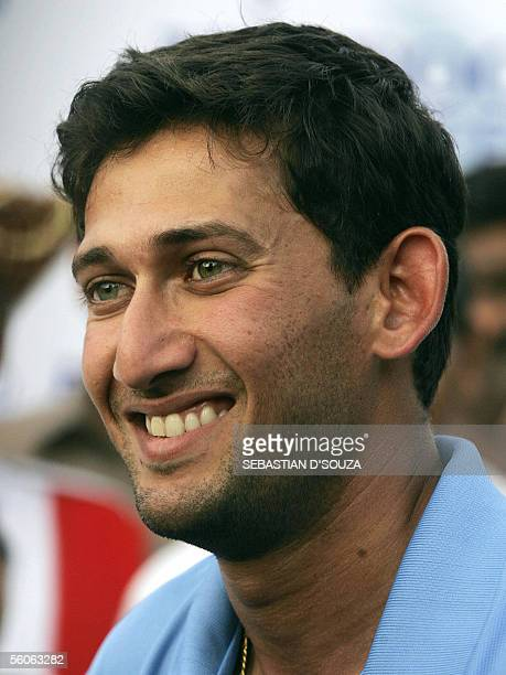 Indian cricketer Ajit Agarkar smiles after being declared 'Man of the Match' as he attends the prize distribution at the conclusion of the fourth One...