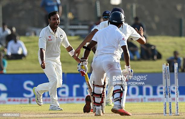 Indian cricketer Amit Mishra and teammates celebrate after dismissing Sri Lankan batsman Kaushal Silva during the second day of the opening Test...