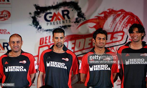Indian cricketer and captain of IPL's Delhi Daredevils team Virender Sehwag poses with Bollywood Actor Akshay Kumar teammates and Pakistani...