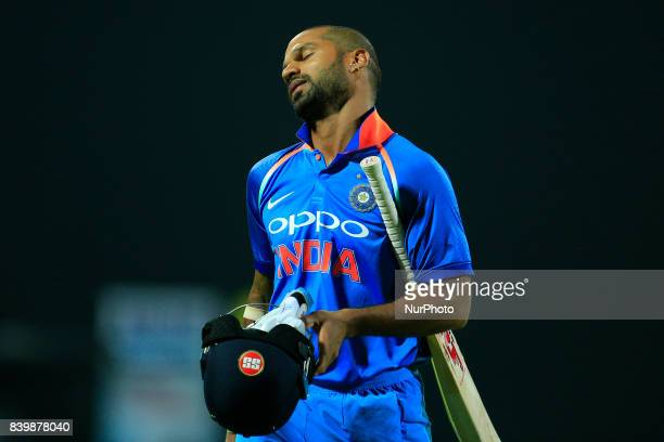 Indian cricketer and opening batsman Shikhar Dhawan reacts as he walks back following his dismissal during the 3rd One Day International cricket...