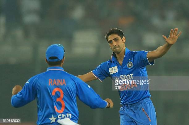 Indian cricketer Ashish Nehra celebrates after the dismissal of Pakistan cricket player Mohammad Hafeez during the match between India and Pakistan...