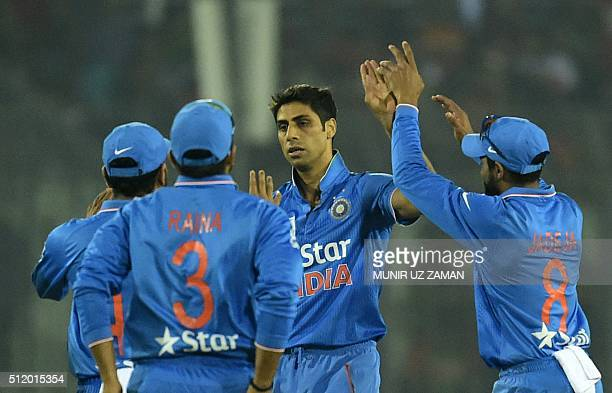 Indian cricketer Ashish Nehra celebrates with teammates after the dismissal of Bangladesh batsman Mohammad Mithun during a Twenty20 cricket match...