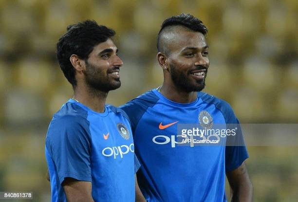 Indian cricketer Bhuvneshwar Kumar and Hardik Pandya look on during a practice session at The RPeremadasa Stadium in Colombo on August 30 2017 The...
