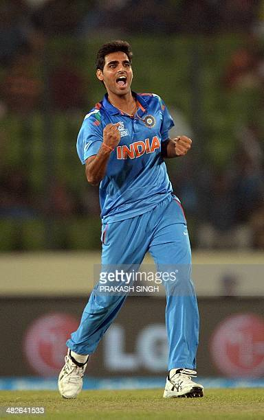 Indian cricketer Bhuvneshwar Kumar celebrates the wicket of South Africa batsman Quinton de Kock during the ICC World Twenty20 cricket tournament...