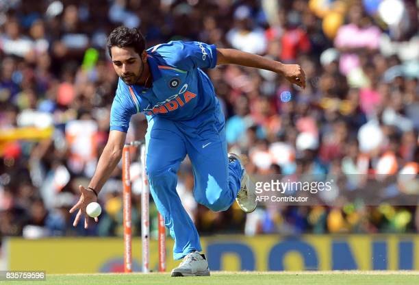TOPSHOT Indian cricketer Bhuvneshwar Kumar dives as he attempts to field a ball hit by Sri Lankan cricketer Dhanushka Gunathilaka during the first...