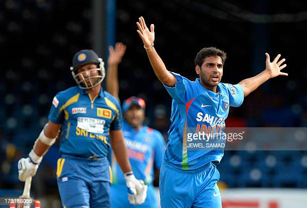 Indian cricketer Bhuvneshwar Kumar successfully appeals for LBW against Sri Lanka batsman Kumar Sangakkara during the sixth match of the TriNation...