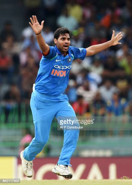 Indian cricketer Bhuvneshwar Kumar unsuccessfully appeals for a Leg Before Wicket decision against Sri Lankan captain Upul Tharanga during the final...
