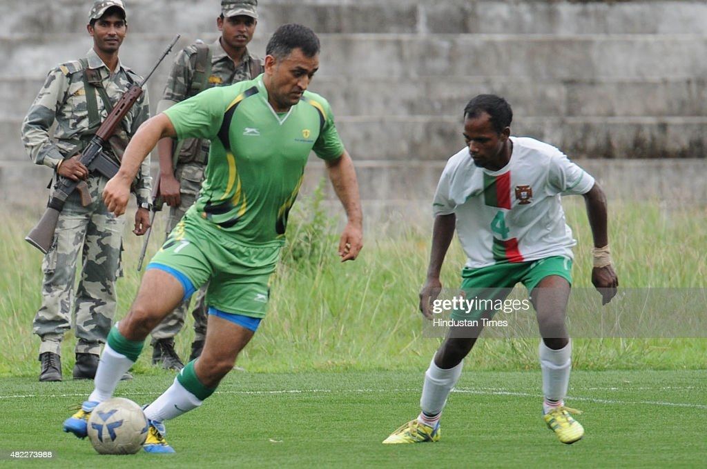 Indian Cricketer MS Dhoni in action during an exhibition football match played in a football stadium in Silli on July 29 2015 in Ranchi India