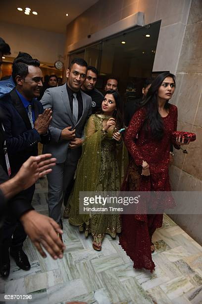 Indian Cricketer MS Dhoni with his wife Sakshi Dhoni during the wedding reception of Indian Cricketer Yuvraj Singh and Bollywood actor Hazel Keech at...