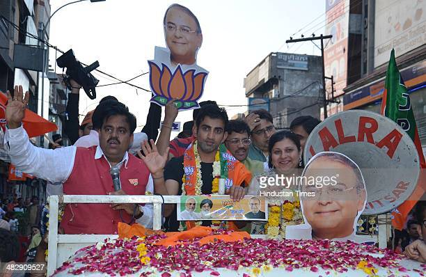 Indian cricketer Gautam Gambhir along with Sonali Jaitley daughter of Arun Jaitley and Kamal Sharma BJP State President during an election campaign...