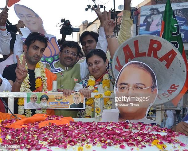 Indian cricketer Gautam Gambhir along with Sonali Jaitley daughter of Arun Jaitley and Kamal Sharma BJP State President during an election campaign...