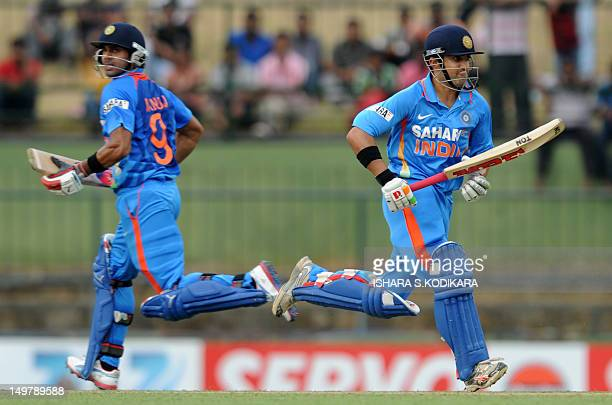Indian cricketer Gautam Gambhir and Manoj Tiwary run between the wickets during the fifth and final oneday international match between Sri Lanka and...