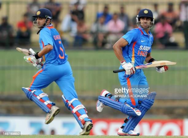 Indian cricketer Gautam Gambhir and Manoj Tiwary run between wickets during the fifth and final oneday international match between Sri Lanka and...