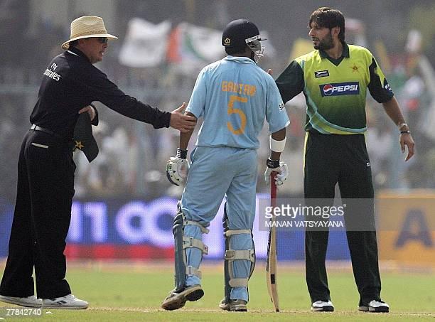 Indian cricketer Gautam Gambhir and Pakistan's Shahid Afridi exchange words during their third Oneday International match at the Green Park Stadium...